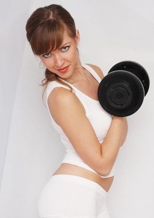woman with big dumbbell photo