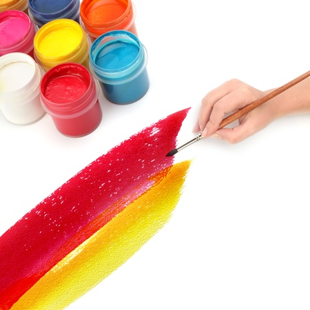 hand with brush and paint photo