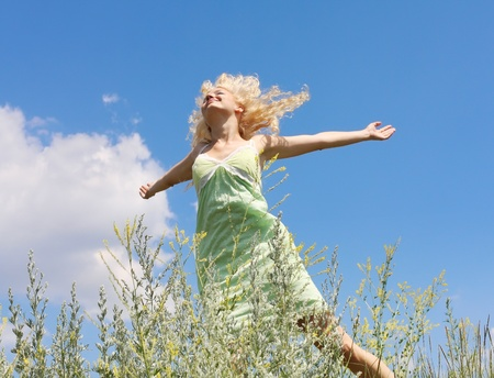 young woman under blue sky Stock Photo - 9442676