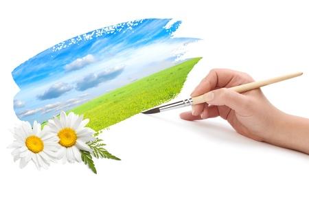 hand with brush and landscape photo