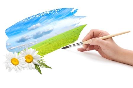 Main avec pinceau et paysage Banque d'images - 9442684