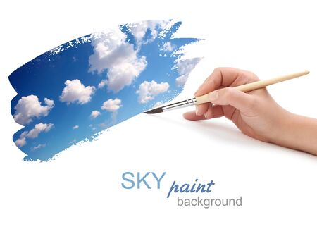 hand with brush and sky paint Stock Photo - 9233136