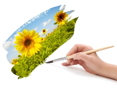 sunflower drawing: hand with brush and landscape
