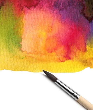 Watercolor painted background with brush photo