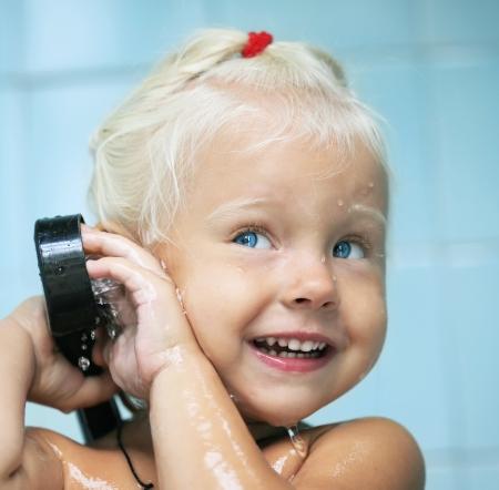 little baby child girl in bath photo