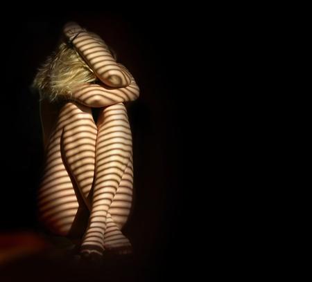 girl alone: nude woman in the dark