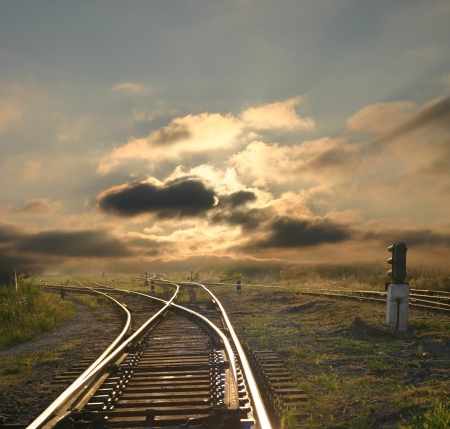 railroad station platform: evening landscape with railroad rails