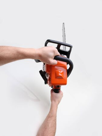 doom: man hands holding a chainsaw Stock Photo