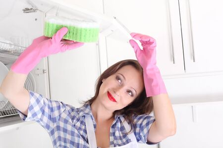 woman cleaning kitchen photo