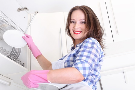 rubber glove: smiling woman in kitchen
