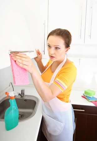 woman cleaning kitchen Stock Photo - 14960720