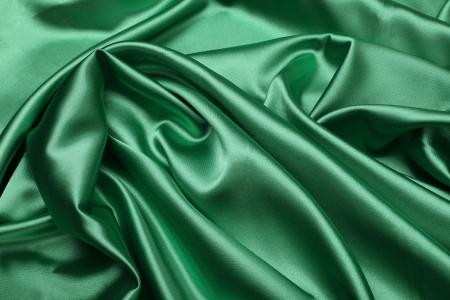 raso: di seta verde tessuto di fondo Archivio Fotografico
