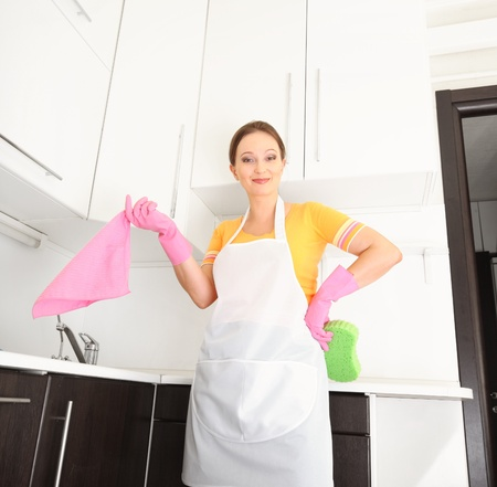 scouring: woman in kitchen Stock Photo