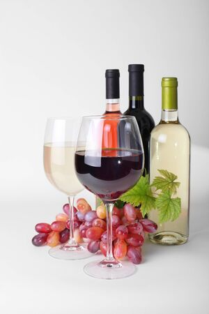 aligote: wineglass, bottles of wine and grapes