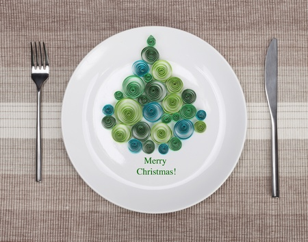 White plate with christmas tree photo