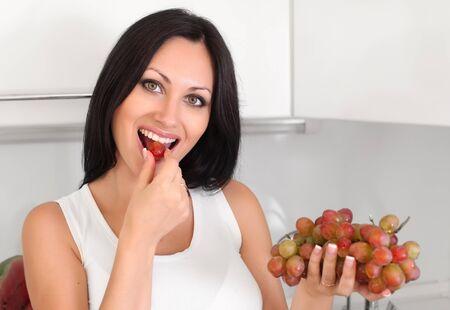 woman eating grapes photo