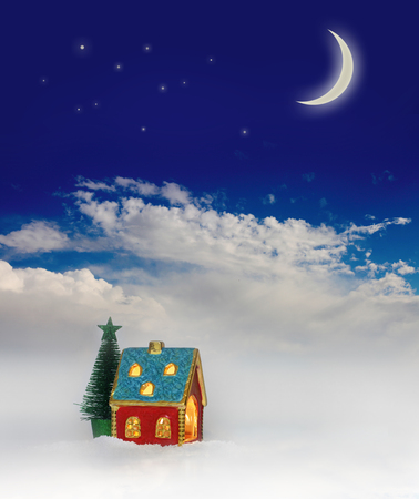 Christmas festive light in house under blue sky photo