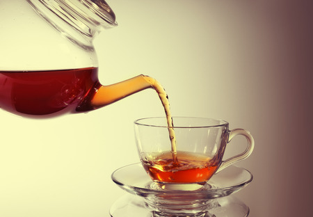 teacup: Pouring tea to a teacup Stock Photo