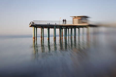 soft   focus: Pier in sea water. Soft focus. Made with lensbaby.