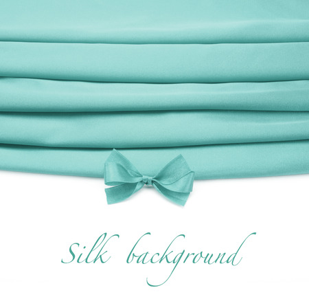 sheen: turquoise silk fabric with bow