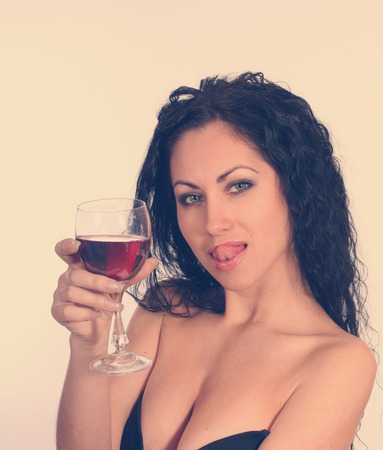 Woman with wineglass. Retro vintage style. photo