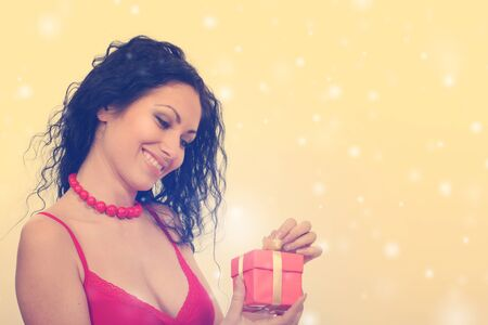 Woman with gift box. Retro vintage style. photo