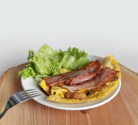 scrambled eggs: scrambled eggs omelette with bacon Stock Photo