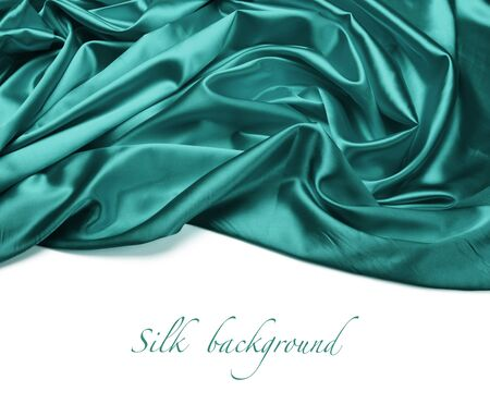 blue silk: turquoise silk fabric background Stock Photo