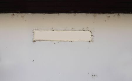 label frame: label frame on empty old wall