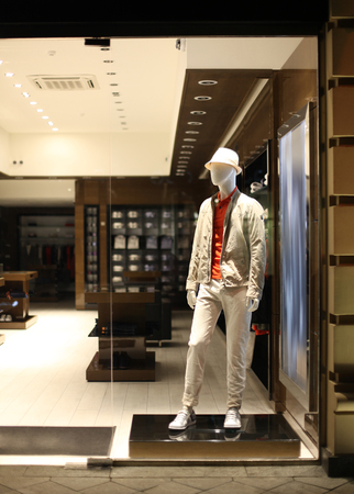 show case: night shopwindow with men dressed mannequins