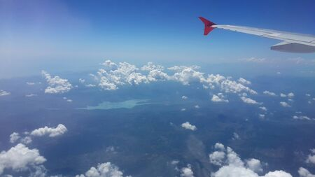 cloude: airplane view window on sky background