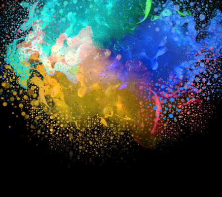 Acrylic colors in water with dropsr. Abstract background. Isolated on black.