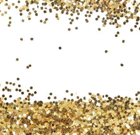 Gold glitter texture isolated on white. Abstract background.