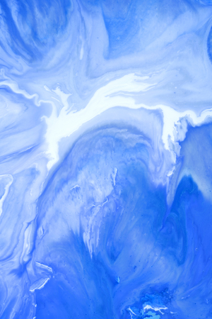 Blue blots. Abstract background. Marble texture. Acrylic colors.
