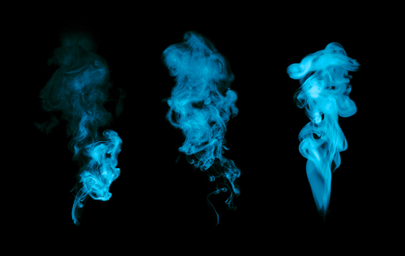 Blue fire smoke blot isolated on black background.