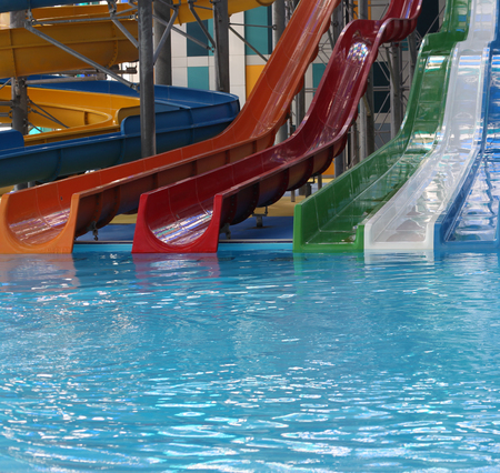 Water park. Blue pool slide swimming. Aquapark. Stock Photo - 119975786
