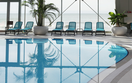 Spa area with blue swimming pool