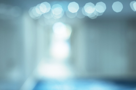 De-focuses business center interior. Blur background. Blue tone.