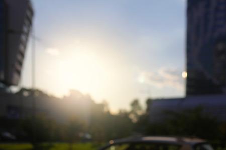 Abstract street city light blur blinking background. Soft focus. Sunset sky.