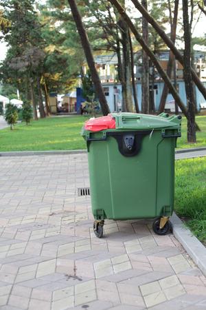 Big green plastic dumpster on the street Stock Photo - 119976165