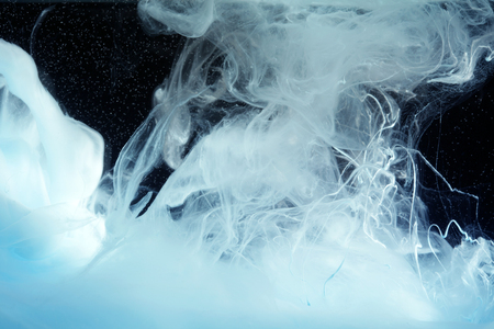 Acrylic blue colors in water. Ink blot. Abstract background. Stock Photo
