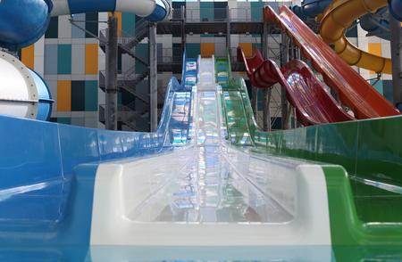 Water park. Blue pool slide swimming. Aquapark.