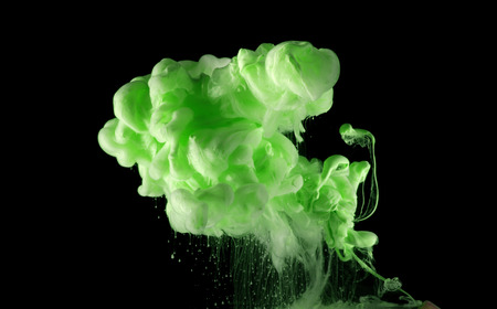 Acrylic green colors in water. Ink blot.