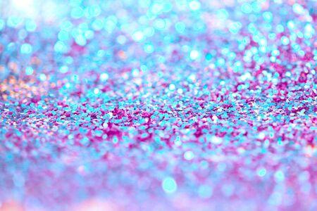 Ultraviolet glitter shine dots confetti. Abstract light blur blink sparkle defocus background.