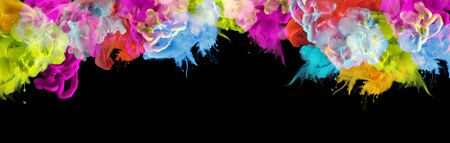 Acrylic blue, green, yellow and red colors in water. Ink blot. Abstract black background. Horizontal long banner. Festival,  party creative concept.