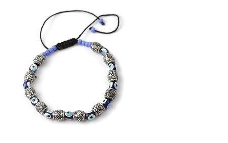 Stone, metal, glass Bead bracelet on white background.