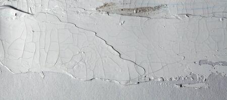 Grey brush stroke on gray empty wall. Reklamní fotografie