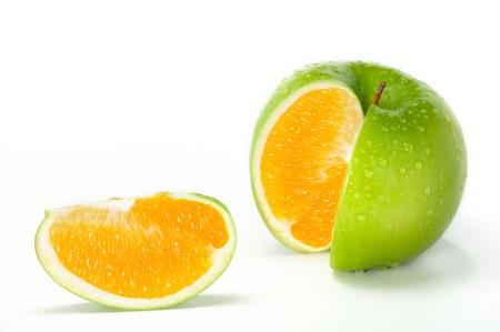 Apple Orange.Close-up image of fresh green apple combined with orange.