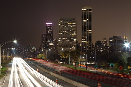multiple lane highway: Chicago. Image of Lake Shore Drive Highway leading to the city of Chicago at night. Stock Photo