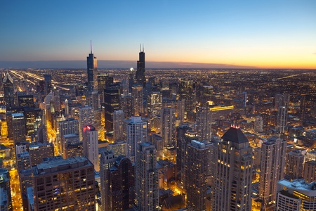 suburb: City of Chicago. Aerial view  of Chicago downtown at twilight from high above.